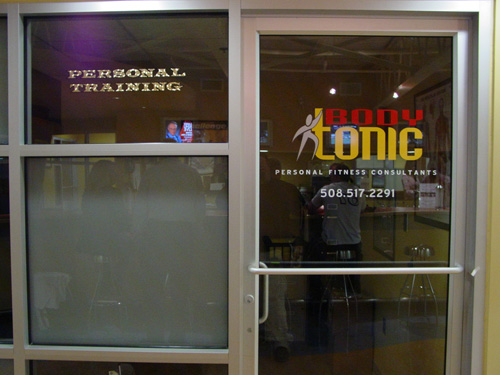 custom storefront vinyl window lettering